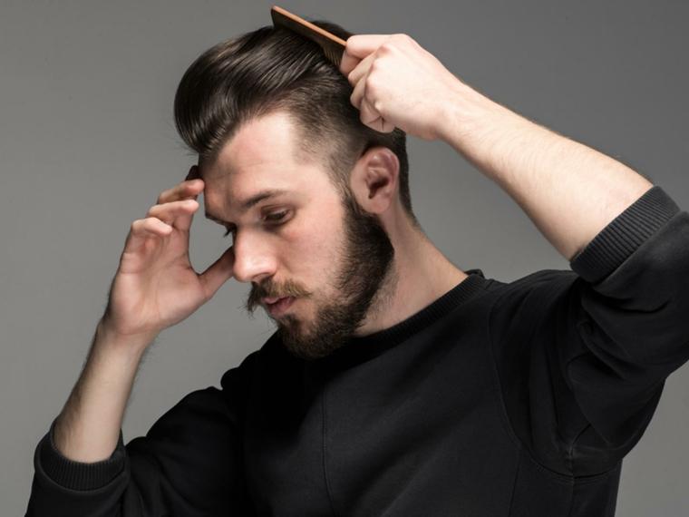 ottima proposta per tagli di capelli uomo corti ai lati, barba e maglione nero