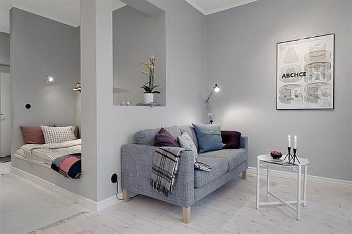 Idee per un arredamento salotto moderno con divano grigio in tessuto