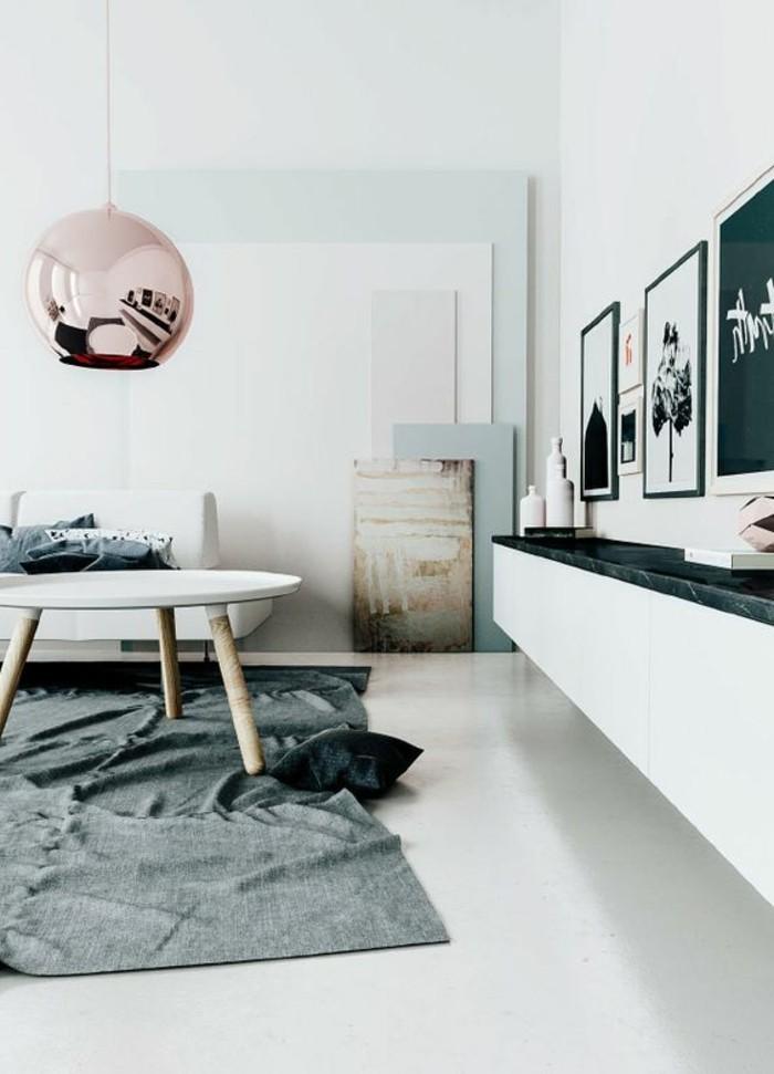 Idea per un salone moderno con un tavolino basso e decorazioni con quadri artistici