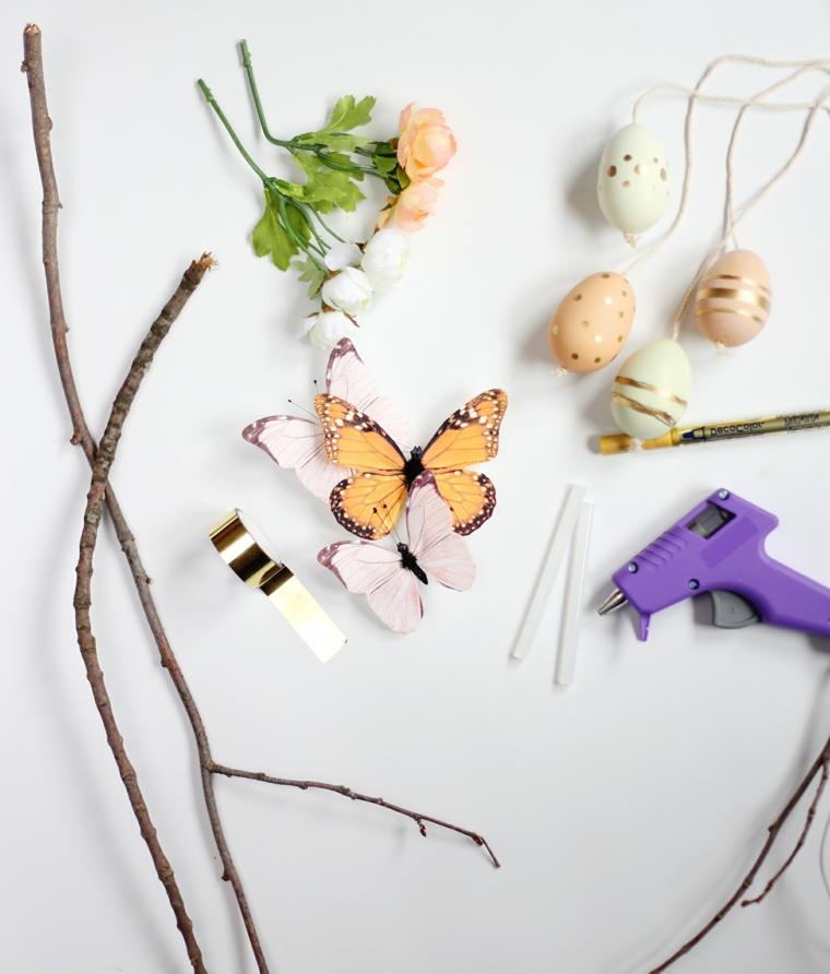 tutto il necessario per realizzare il progetto, rami, fiori, colla a caldo uova decorate e nastro oro