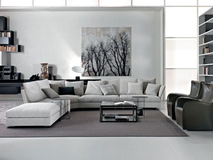 Arredare e decorare la zona giorno con un divano ad angolo e quadro da parete