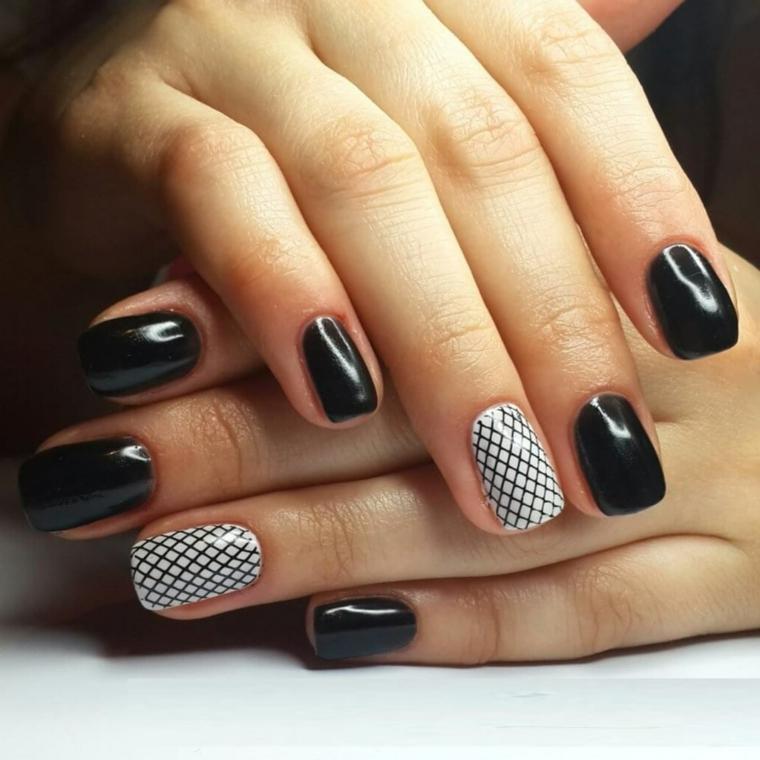Come decorare le unghie di colore nero, accent nail con base bianco e disegno rete nera