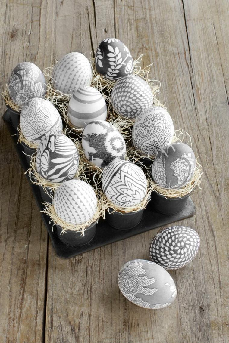 Decorazioni uova nella tonalità di colore grigio, effetto pizzo e base di pezzi di canapa