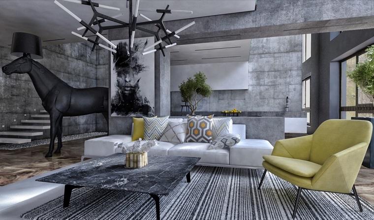Interni case moderne, pareti colore grigio, tavolino basso effetto marmo, lampada sospensione design, arredamento con divano e poltrona