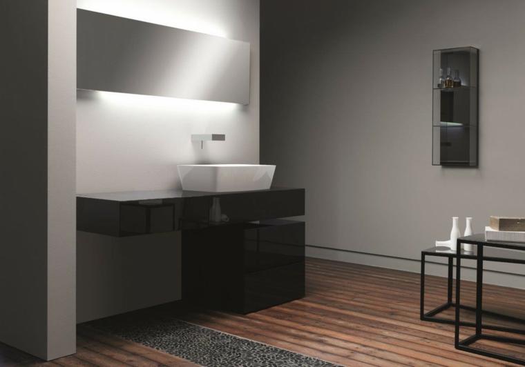 Idee rivestimento bagno, pareti grigie, mobile laccato di colore nero, illuminazione led