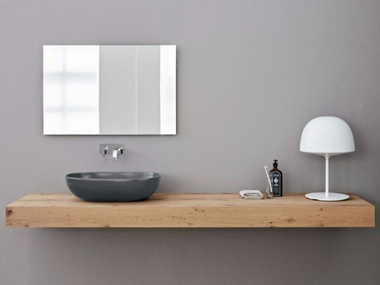 Top di legno, lavandino forma arrotondata con miscelatore da parete, arredo bagno moderno