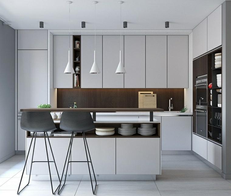 Arredamento moderno, cucina con isola centrale, elettrodomestici da incasso, pavimento gres colore grigio