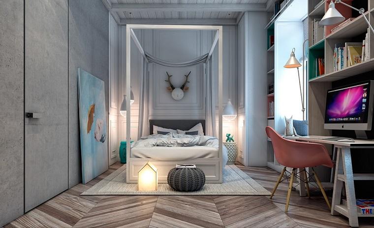Cameretta decorata con accessori e quadri, struttura letto in legno, pavimento parquet colore chiaro