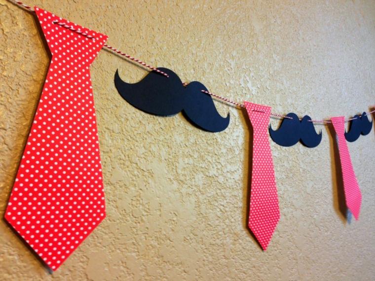 ghirlanda con spago cravatta e baffi di carta appesi alla parete per la festa del papà