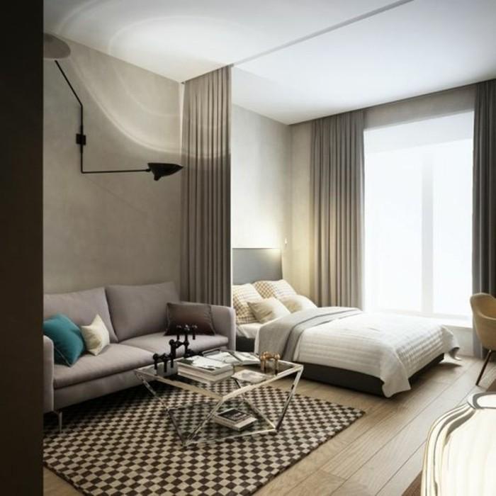 una proposta per arredare piccolo appartamento con una tenda che divide il living dalla zona notte