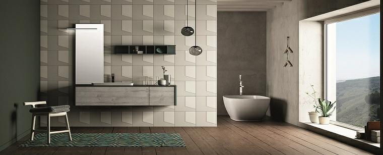 Rivestimenti bagni esempi, mobile legno sospeso, specchio con lampada led, vasca da bagno freestanding