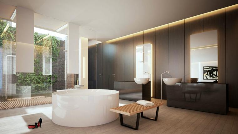 Sala da bagno con vasca forma arrotondata, rivestimenti bagni esempi, mobili in legno laccato