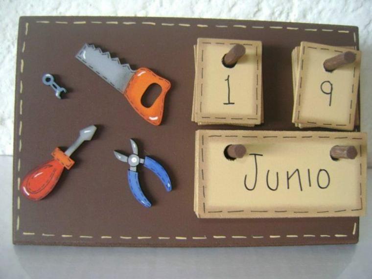 lavoretti festa del papà con materiale riciclato calendario fai da te con disegno di strumen artigianali