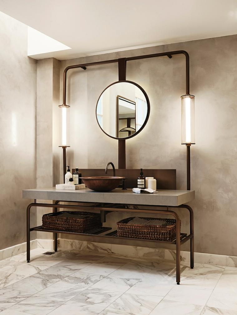 Piastrelle bagni moderni, mobili di metallo, top di cemento, specchio rotondo e lavandino da appoggio in rame