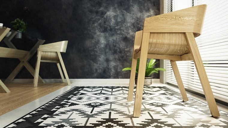 Salotto con mobili di legno, case moderne interni, parete tinta di colore nero sporco, sedia di legno colore chiaro