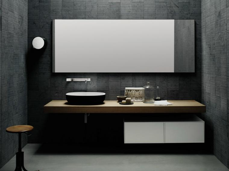 Piastrelle bagni moderni, colore nero in abbinamento al bianco, mobile sospeso e lavabo da appoggio