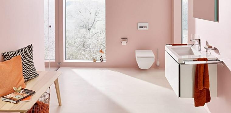 Rivestimenti bagni moderni immagini, pareti di colore rosa, lavandino sospeso di colore bianco, panchina di legno