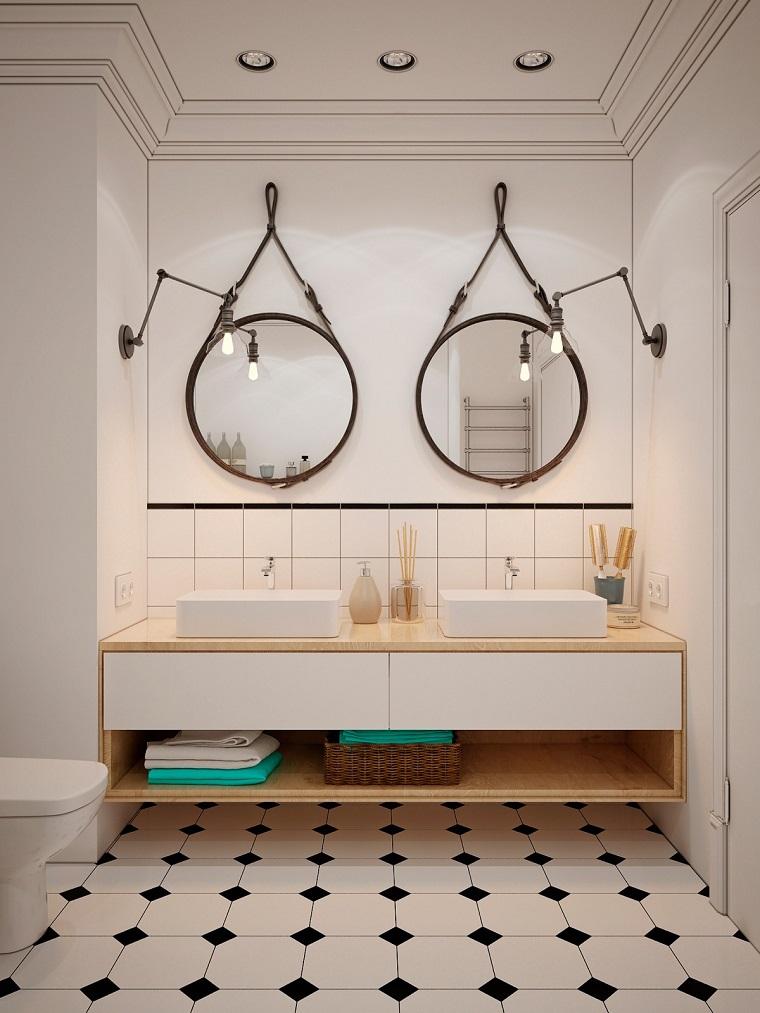 Arredamento moderno, bagno con un mobile di legno e due lavandini da appoggio
