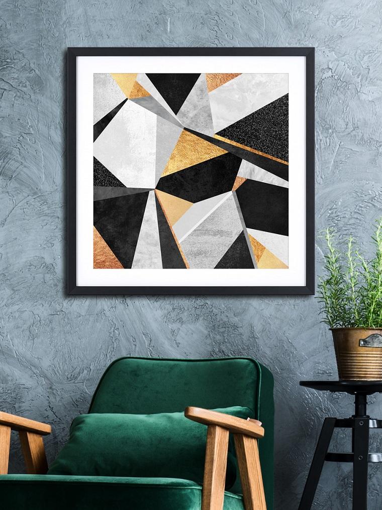 Stili di arredamento, soggiorno arredato con una poltrona di colore verde, manici in legno, decorazione con quadro motivi geometrici colorati