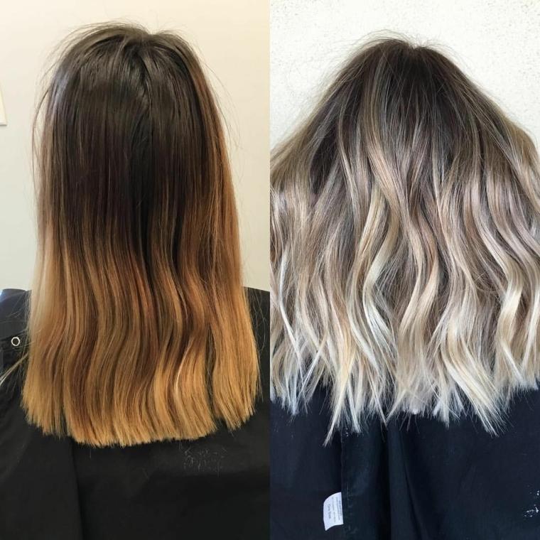 il risultato di un trattamento balayage capelli dai toni biondo platino, piega ondulata