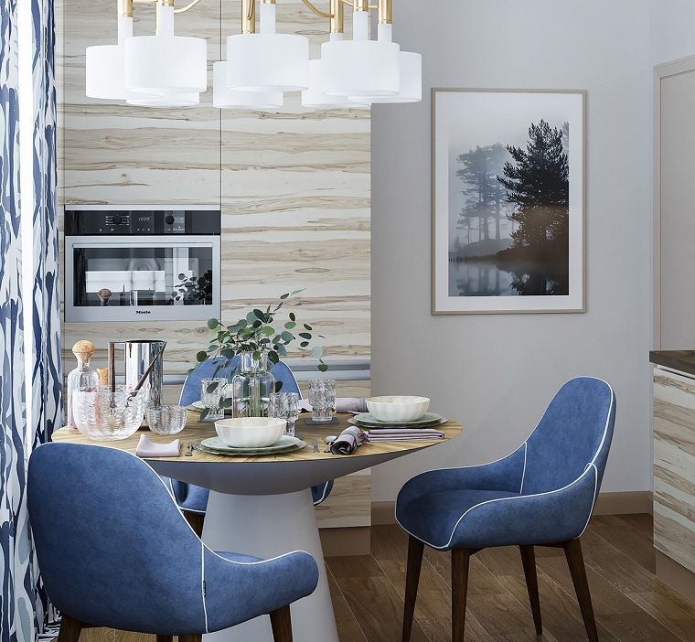 Cucina con set di mobili da pranzo, tavolo rotondo e sedie blu, idee arredo casa, lampadario sospensione plafoniere rotonde bianche