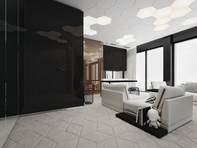 Tappeto colore grigio chiaro in memory, arredamento moderno, salotto con divano colore bianco, parete nero lucido