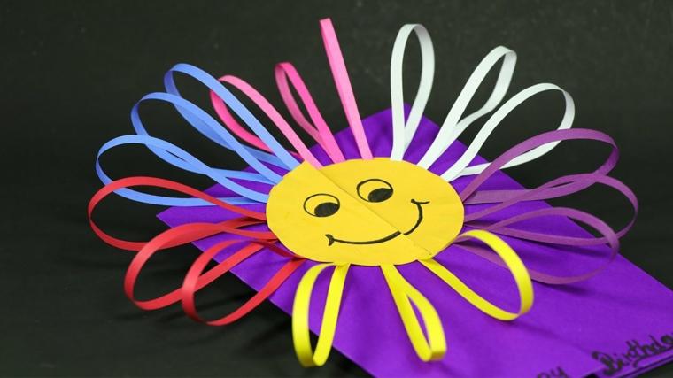 idea colorata e divertente per realizzare un invito ad una festa di compleanno con un solo e raggi colorati