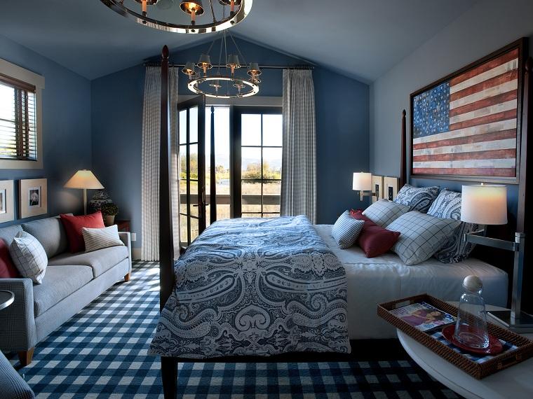 Camera da letto stile tradizionale, interni case moderne, arredamento con divano grigio e tavolo bianco rotondo
