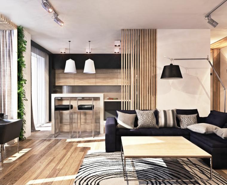 arredamento moderno di un open space con cucina e soggiorno con parete divisoria in legno