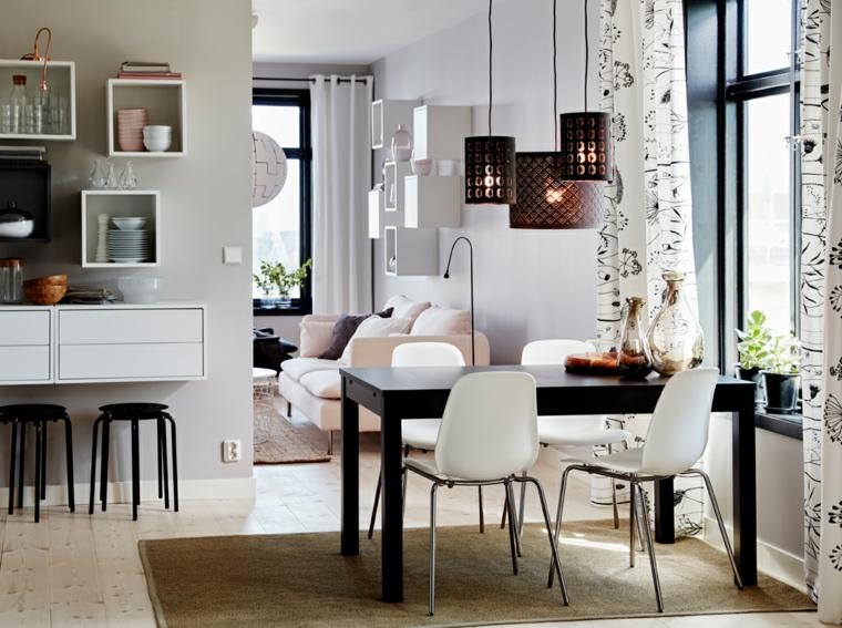 proposta per mobili soggiorno moderni con divano bianco e zona pranzo con tavolo nero e sedie bianche