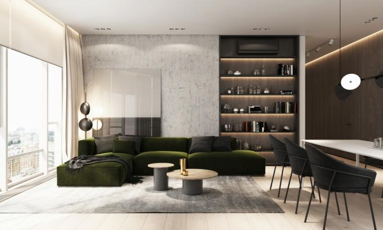 Libreria integrata nella parete, divano di colore verde, tappeto grigio, esempi arredamento soggiorno