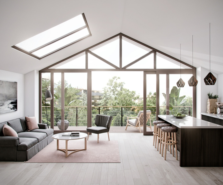 Soggiorno con pavimento in legno, cucina con isola centrale, soffitto in pendenza