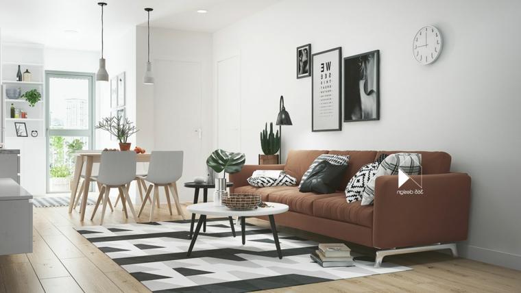 Sala da pranzo e salotto insieme, divano colore marrone, tappeto con print geometrici