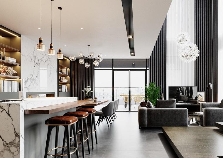 Esempi arredamento soggiorno, cucina con isola, pavimento in legno rialzato, lampadari sospesi