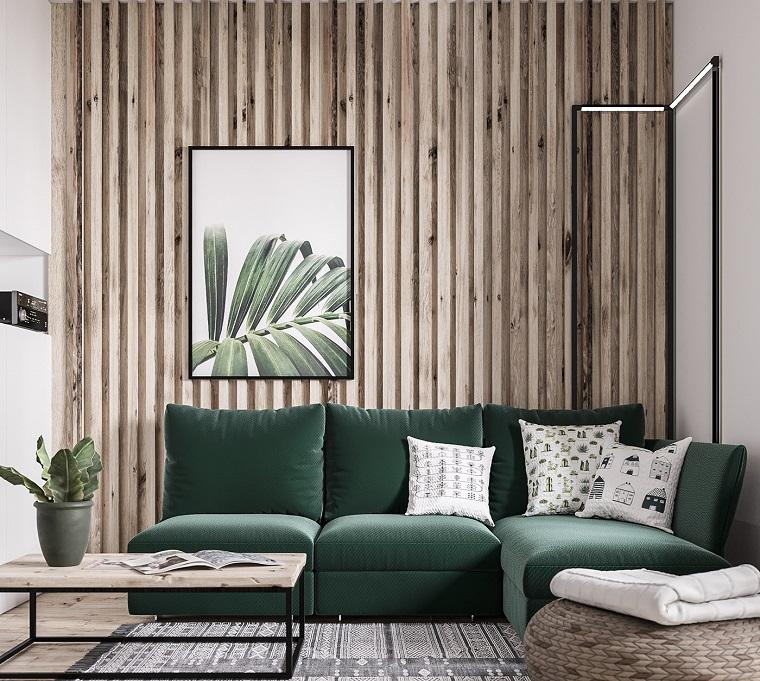 Come arredare un soggiorno rettangolare, divano di colore verde, parete rivestita di legno