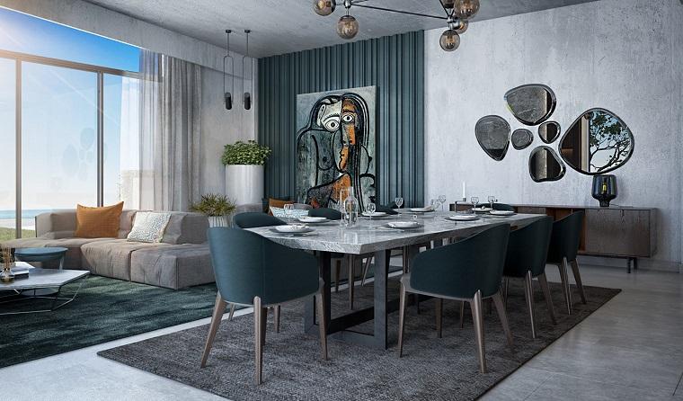 Tavolo da pranzo con sedie, pavimento con tappeti, arredare cucina soggiorno ambiente unico