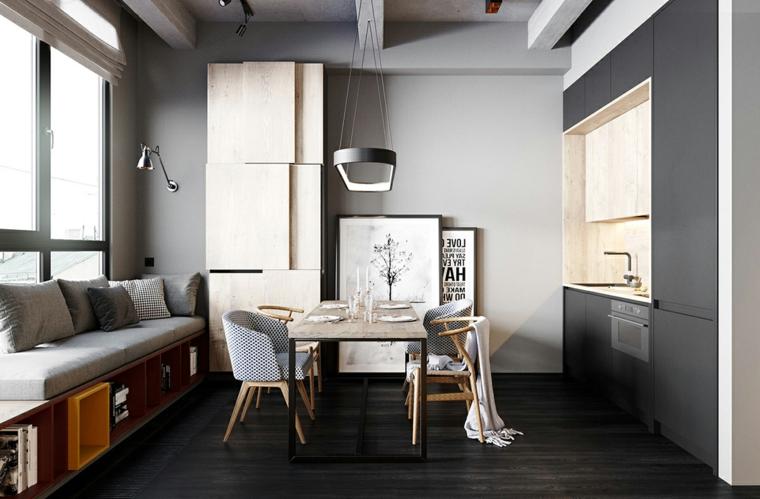 Arredare piccoli spazi, tavolo da pranzo in legno, divano di colore grigio, quadri da parete