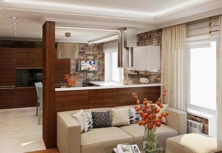 Cucina con mobili di legno, divano due posti, tavolino con vaso di fiori