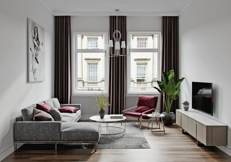 Salotto con divano angolare, tappeto di colore grigio, mobile di legno per la tv