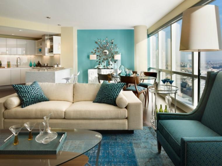 arredamento per un open space con zona pranzo, angolo cucina e salotto e parete turchese, idee per tinteggiare il salotto