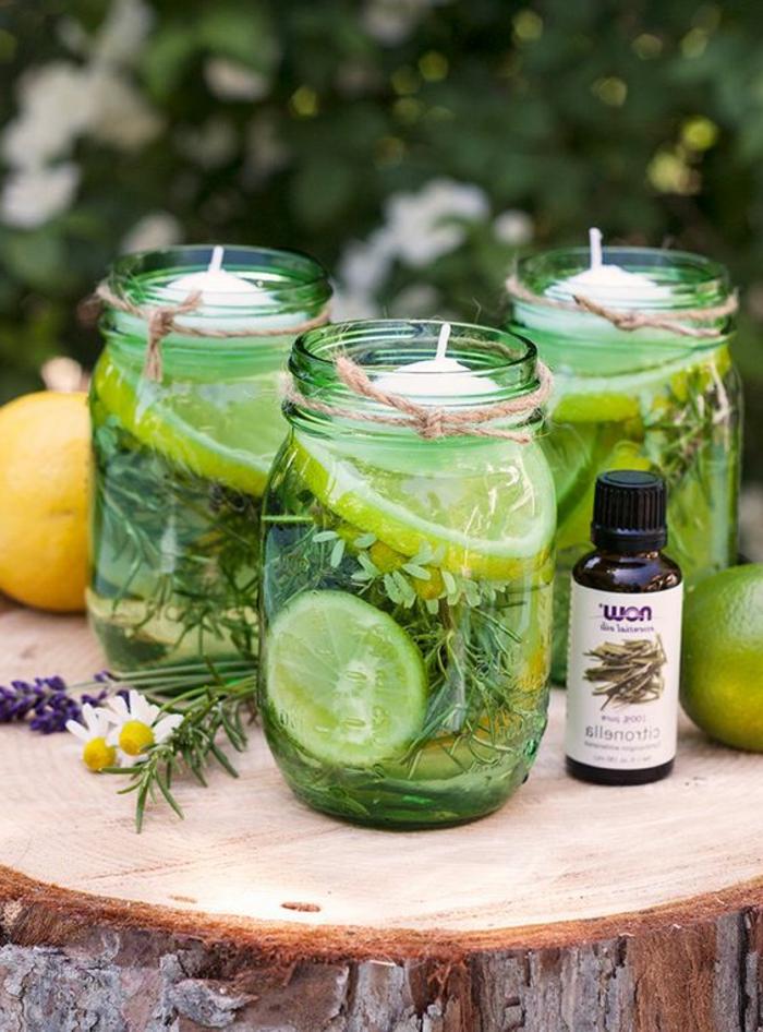 Candele fai da te, barattoli di vetro riutilizzati, aggiungere olio essenziale e fette di agrumi