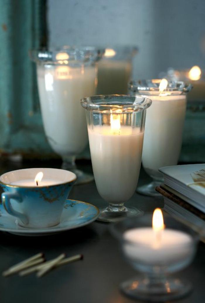 Stoppino candela, bicchieri di vetro e tazzine utilizzate come portacandele