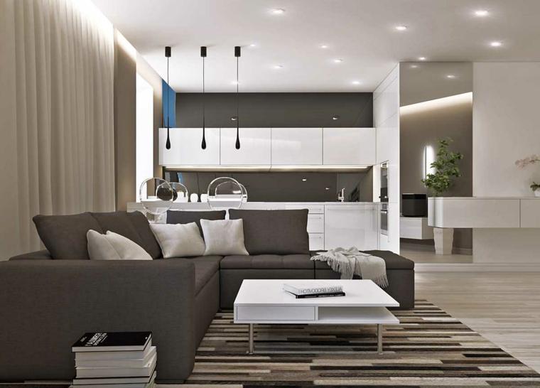 Cucina di colore bianco, divano angolare, tavolino basso bianco