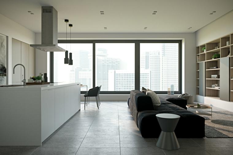 Arredamento cucina con mobili di colore bianco e superfici lucide, divano al centro dell'ambiente