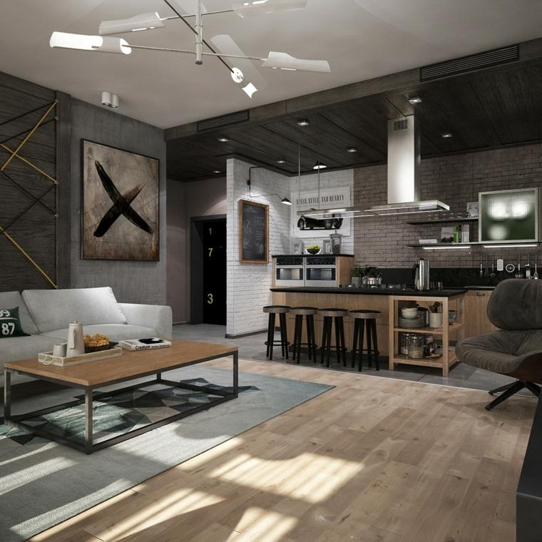 Arredare cucina soggiorno ambiente unico, isola centrale con sgabelli alti, tavolino e divano grigio