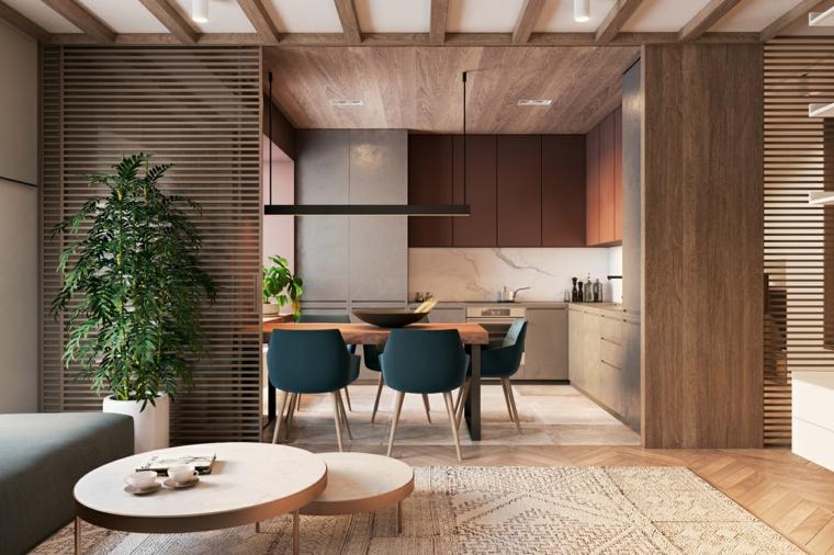 Cucina soggiorno open space, tavolini rotondi bassi, due tipi di pavimento, soffitto con travi di legno