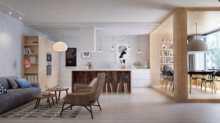 Arredare cucina soggiorno ambiente unico, mobili in legno colore chiaro, parete con mattoni in vista bianchi