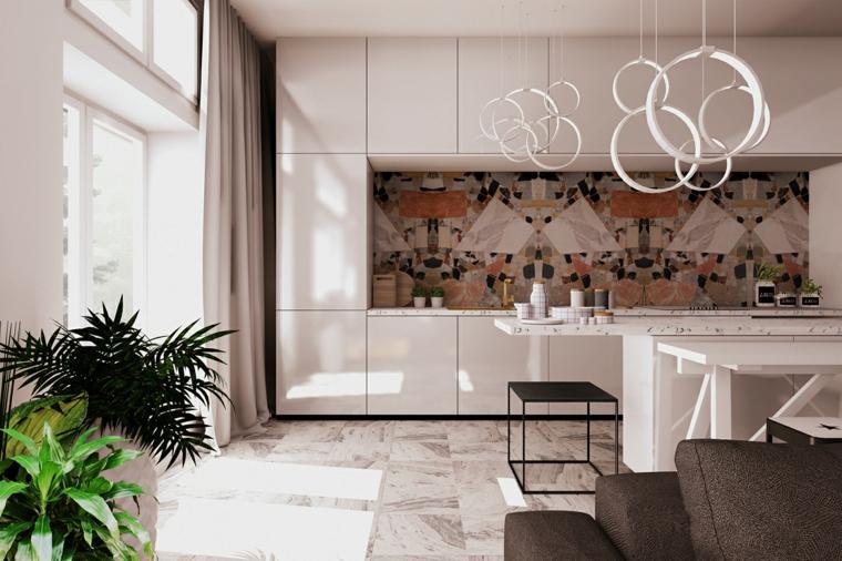Decorazione open space con piante da appartamento, cucina con mobili lucidi di colore bianco