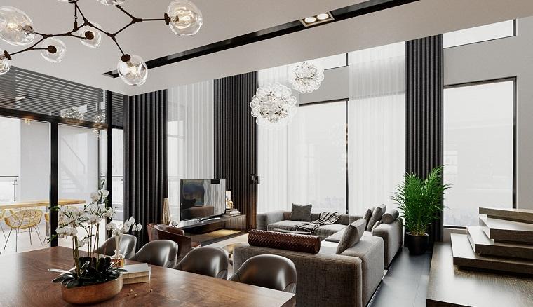 Pavimento rialzato di legno, arredare salotto e sala da pranzo insieme, divano angolare grigio
