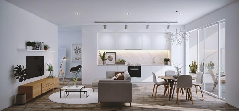 Sala da pranzo e salotto insieme, cucina di colore bianco, pavimento in legno